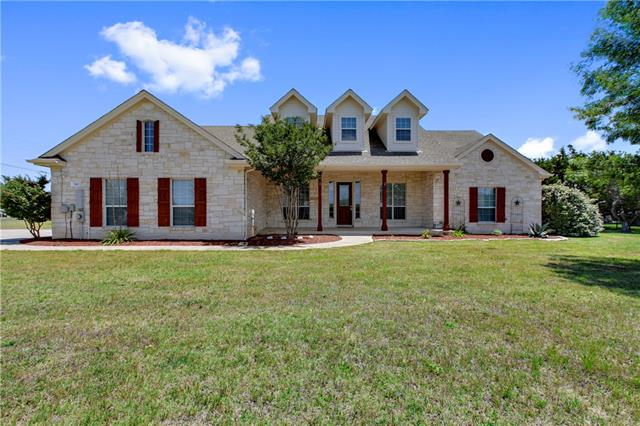 **Pre-Qualified Buyers Only**Stunning white stone exterior on 1.24 acre lot, Seller needs 1 hour notice, Please use CSS to schedule-Corner Lot, Energy efficient a/c, recent septic pump, huge bonus game/craft room upstairs, updated lighting and faucets, 2 car side-entry garage, playscape remains, highly desirable upscale gated community, large covered front porch, beautiful curb appeal, covered patio, impeccable condition, all bedrooms downstairs, desirable Liberty Hill schools, easy commute to Austin.