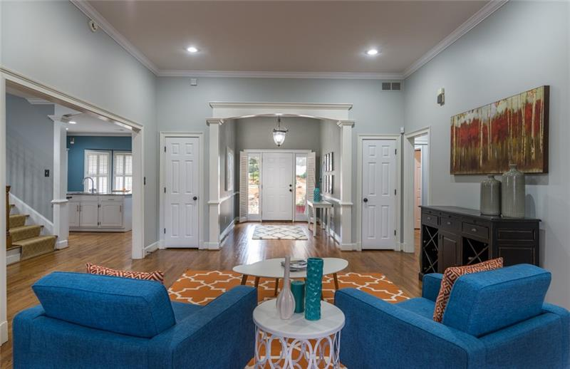 Stunning foyer open up to oversized living room/sitting room!