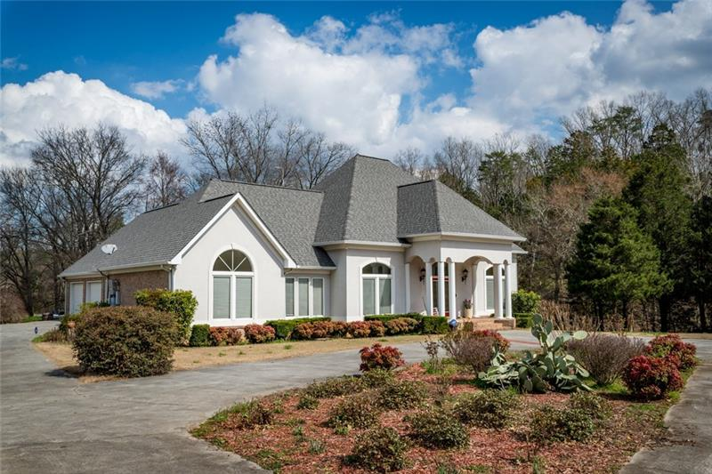 Welcome Home to this beautiful home on 10 Acres with a Creek and small Pond on property