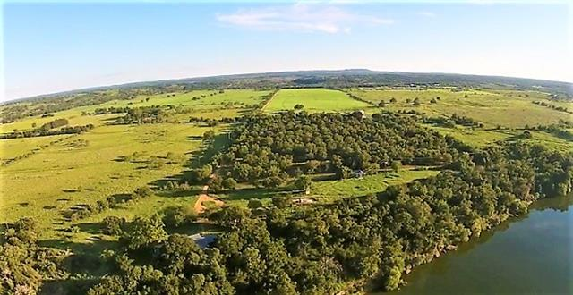 Truly unique offering, Rancho Ventura provides the rare opportunity to own 84± acres while enjoying 850± feet of pristine water frontage on the upper end of Lake Travis. The property boasts a craftsman ranch home, guest house, 60± acres of rolling mature coastal hay, & a 300± tree pecan orchard. Great opportunity for a vineyard, event center, wedding venue, & more! Located inside one hour from Austin in the highly desirable Colorado River valley, Rancho Ventura offers both convenience & seclusion.