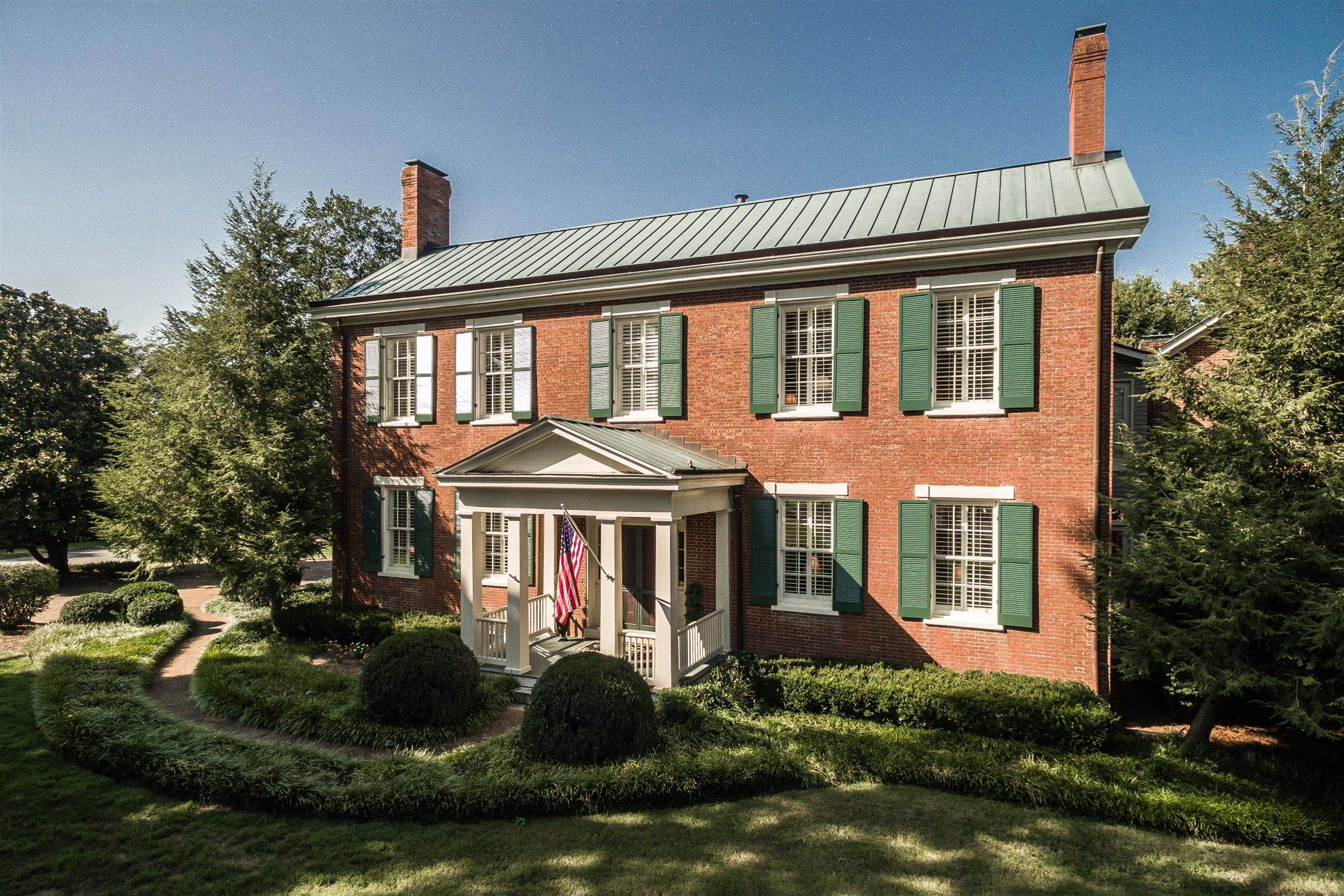 STUNNING ANTEBELLUM HOME IN OLD HICKORY! Just 13 miles from Nashville. In a Lakeside Community, the Shute Turner Plantation House, Circa 1833 is located on land once owned by Andrew Jackson. Typical federal style, 3 bricks thick, 9 fireplaces, Original Poplar Hardwoods, Cherry Cabinetry throughout & 12' ceilings built around a courtyard.