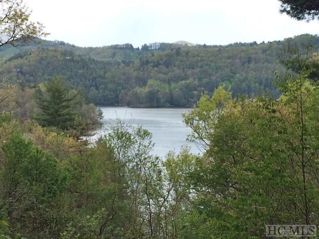 Perfect Lake Glenville lots are rare, indeed, and at this price this .36 +/- stunner is in rare air territory!  Featuring BOTH lake and mountain views, this jewel of a lot is the perfect site for creating your lake memories.  With paved access inside the private community of Admiral's Point, easy building site, underground utilities, and lake access, this site gives you the ultimate canvas for painting your dreams  You'll love life at the lake!