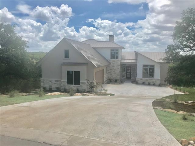 The home estimated completion date October 1.House is located on one of the highest lots in Horseshoe Bay with great panoramic views of the hill country. Upon entering the house you will have outstanding hill country views from the living areas. You will enjoy a spacious outdoor living with a covered patio for morning coffee or evening happy hour with family and friends. The home estimated completion date is October 1.The home has a large living area with great views and upgraded kitchen appliances.