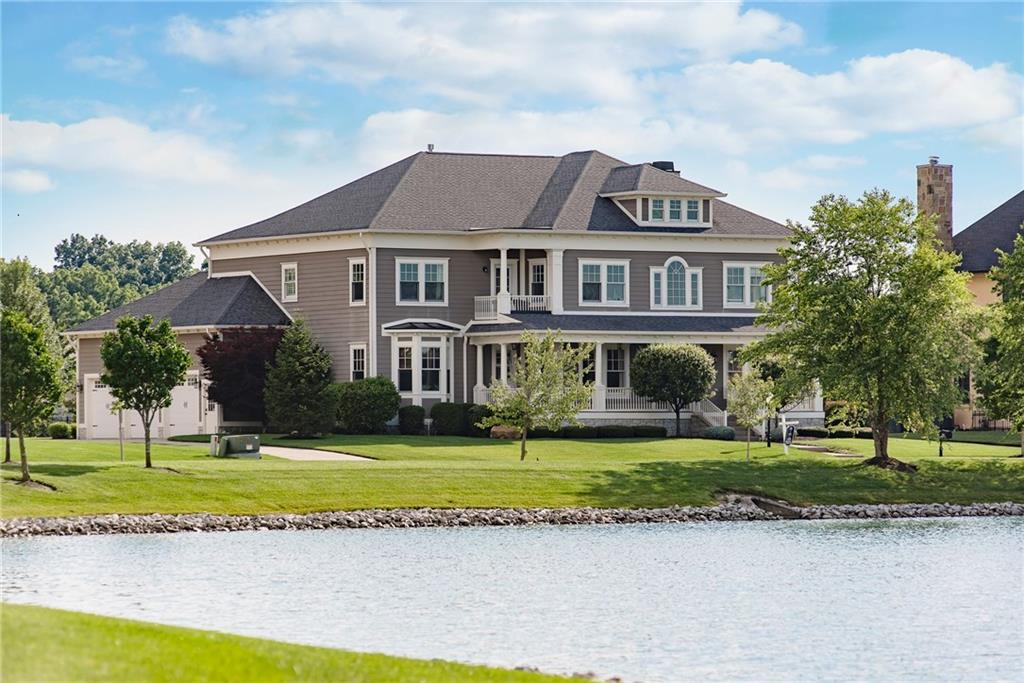 Luxurious Living & Breathtaking Water Views on this must-see custom masterpiece. Great attention to detail throughout this home w/ beautiful hardwood floors, arches, wainscoting, tray ceilings & plantation shutters.  Grand 2 story Foyer, Dining Room and Office.  Great Room w/ fireplace & open to Kitchen perfect for entertaining.  Stunning Gourmet Kitchen w/ extra large center island w/ seating space for 5 , stainless steel appliances, double ovens and spectacular eat-in area w/ gorgeous windows & built-ins. Master Suite w/ fireplace, great bathroom & walk-in closet.  Lower Level w/ open rec room, fireplace, wet bar & workout room.  Water views from front porch.  Covered porch w/ fireplace and patio overlooking backyard.