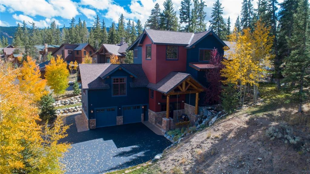 Magnificent custom Lodge-Style home is one of the finest-built in the subdivision. Backs to Nat'l Forest, this home has views and access. Warm up in front of one of three fireplaces, make lasting memories in one of the gathering spots.Relax into the spaciousness this of 5 bedrooms plus 2 offices, work out room, laundry room and master W/D. Great room, family room & master have vaulted ceilings. Beautiful stone work, walnut floors. garage can be enlarged for storage of mntn. toys.