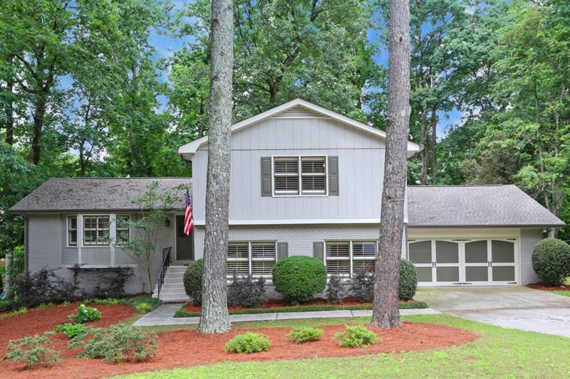WOW! Fully renovated Village Mill home! LARGE, fully fenced, FLAT backyard with NEW deck! NEW roof and gutters! FRESH exterior paint! Spacious and OPEN floor plan! The kitchen features beautiful white cabinets, stainless steel appliances, GRANITE countertops and opens to the LARGE dining room and family room! SPACIOUS master bedroom and bathroom with walk-in closet, dual sinks, and walk-in shower! ABUNDANT storage throughout including partially unfinished basement! Conveniently located near I-285, Dunwoody Village, and minutes from top ranked Dunwoody Elementary! You're also eligible to join the Village Mill swim/tennis club! This is the home you've been waiting for!