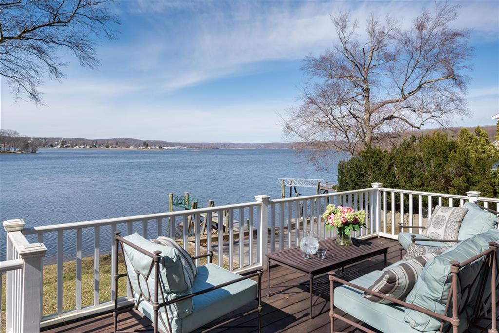 Magnificent Waterfront listing with private beach and permitted dock.  Captivating Panoramic views of the lower CT river that expand for miles from almost every room. The South cove views capitulate the Charming Essex village and Marina.  The 4,134 square foot home features a thoughtful renovated kitchen with Thermador oven range with six burners, Sub zero refrigerator/freezer delicately hidden in custom cabinetry and central island that beckons entertainment. Property is wrapped in windows and sliding glass French doors that allow sunlight and abundant views.   Master suite showcases fireplace and a  private balcony perfect for breakfast coffee.  Enjoy spectacular sunrises and sunsets on the sprawling decks and patios.     Minutes from Historic Essex village boutiques and restaurants,  beach community of Old Saybrook and easy access to train station and highway make living here convenient for all.