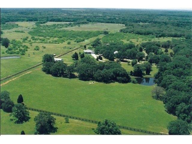 36+/- acres of privacy with TWO meticulously maintained homes in Mcdade, TX! Both homes are approx. 1800 sq ft with 2 large bedrooms & 2 baths, both have large covered porches and one with a 2-car garage. Metal 4-stall horse barn, large equipment/hay barn, tractor shed, 3 large horse paddocks with metal loafing sheds, and two stock ponds. Sandy loam soil. Ag exemption. *(Seller will also sell BOTH homes with 35.84 +/- acres separately for $825k.)