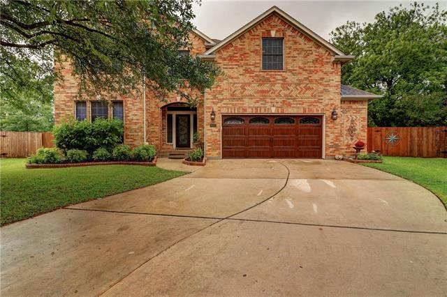 Stunning 5/3.5 brick home at end of cove. Many upgrades! Lrg bckyrd on .26 acres! 2 Master suites. New kitchen backsplash & stainless appl. Endless cabinets & granite counters w/built-in desk & bar. 12' ceilings. Wrought iron stairs. Wired for sec, cams & surround. 2 person jacuzzi tub & shower. Guest suite up. 3 living rooms. Gas FP, Tile & hardwood floors downstrs. New carpet on stairs. Dual Nest thermostats, 2.5 garage has 4-9' shelves, epoxy floor. Close to tennis court, pool, and playground.