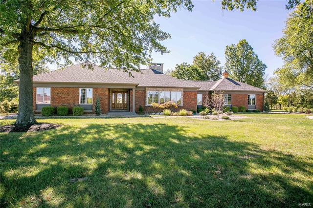 """This nearly full brick ranch is situated on 12.71 acres and with a 40' X 50' outbuilding just minutes from all the conveniences on Wentzville Parkway.  One of Wentzville's newest elementary schools is just around the corner as well.  A complete renovation provides you with a """"like new"""" home from top to bottom in all of today's popular finishes, styles and colors!  It is sparkling clean and private with fabulous landscaping!  The walkout lower level is recently finished offering a family room, rec area, 4th bedroom, and full bath.  The outbuilding has a concrete floor and electric."""