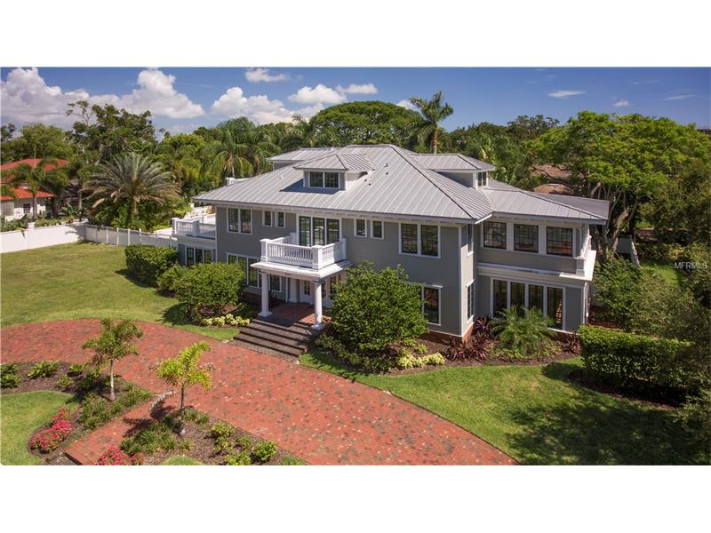 Welcome to 403 Magnolia Dr., an elegant Colonial Revival, estate-style home in the heart of the historic 'Florida Heritage' neighborhood of Harbor Oaks, in downtown Clearwater. This remarkable property (circa 1918-1925) is beautifully restored, updated and modernized throughout. The home features over 9,300 square feet of living space, 7 bedrooms, 7.5 bathrooms, and gleaming hardwood floors on every levels. You will delight over the expansive east and west formal living rooms that are flooded with light through the floor to ceiling windows. Entertain with ease in the sun-filled solarium, library, cozy family room, and formal dining room. The deluxe kitchen features stainless steel appliances, a Dacor gas oven and range and a walk-in pantry. The 1st level also provides a large laundry room that leads to the maid quarters. The 2nd level offers 2 master bedrooms with private access to the wrap around deck and lanai. Each master bedroom comes with its own high-end 'Restoration' style bath. Down the hall are multiple guest rooms and a sun-filled Moroccan-themed living room. The 3rd level offers another master-style suite with a full bath, fireplace, sun deck, and multiple storage rooms. The home sits on over 1/2 acre of beautifully landscaped grounds with an elegant and tropical pool & spa deck. From the home, walk or ride your bike to downtown Clearwater, shopping, dining, and entertainment venues or within a 5 minute drive enjoy the world famous Clearwater Beach! Buyer to verify all measurements.