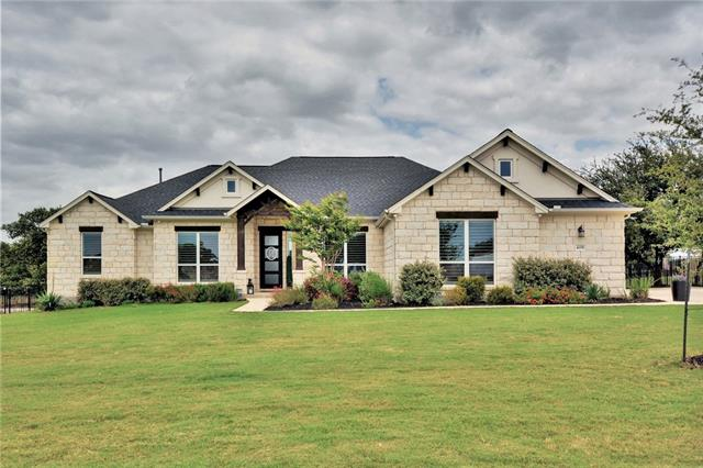 Modern classic hill country home. Luxurious single story 4 beds+study & 3 baths. Functional open floorplan, walls of windows, plantation shutters, beautiful dark hardwoods, stone fireplace has sleek contemporary gas insert. Light & bright kitchen features Carrara marble, lrg island, farm sink & double ovens. Gorgeous mstr retreat, elegant bath his & hers vanities, deep tub, rain shower & impressive walk-in closet. Extended patio, built-in BBQ & water feature. Acreage hm site on flat, fully fenced yard.