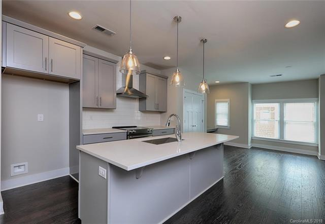 "MOVE IN READY!  Why wait to build in Historic Wesley Heights?  Stunning Brand New Townhome in Grandin Heights with an attached Back Load 2-Car Garage.  Loaded with upgrades...  Hardwoods on all 3 floors (No Carpet whatsoever),  Gorgeous Quartz Countertops in Kitchen & 3 Full Baths, Privacy Wall added on 1st Floor to finish Bedroom 3, Living Room wired for Surround Sound, 2"" White Faux Blinds throughout, Kitchen Features Stainless Steel Appliances, 5 burner electric stovetop, Hood, Dishwasher, and Sharp microwave drawer.  Gorgeous Master Suite with oversized shower with tiled walls and shower pan..  Walking distance to Uptown, restaurants, park and an abundance of night life.  Future Gold Line Trolley anticipated."