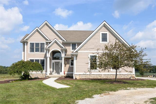 This picture-perfect custom-built home is right out of HGTV and was recently reduced to $499,900! Enjoy 5 acres of privacy on a quiet cul-de-sac with a family-owned farm as your neighbor. Convenient to Chelsea, Dexter, AA, and freeway with school of choice open enrollment. Eat-in kitchen features Brazilian cherry floors, cherry cabinets, granite counters, a large walk-in pantry, and newer SS appliances. Cozy living room with renovated gas fireplace. Formal dining room currently used as den. Sweeping staircase leads to the expansive master suite with vaulted tray ceiling, full bath with shower, soaking tub, and dual vanity, as well as a custom closet. A second bedroom has its own full bath (perfect for guests), and the 3rd and 4th bedrooms share a Jack & Jill bath. Sweeping countryside views from every room. High-end finishes, new lighting, and modern colors throughout. Unfinished walkout and daylight lower level is ready for your finishing touches! Energy-efficient appliances. Whole-ho