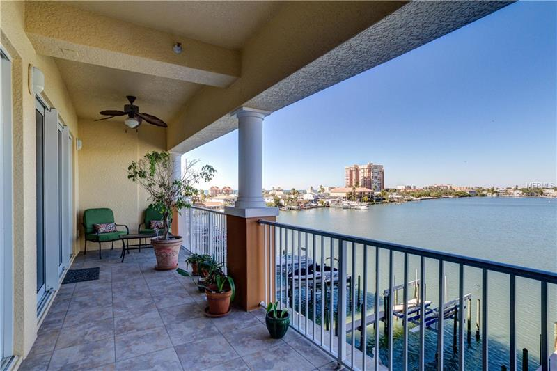 This beautifully appointed custom condo has (3) three bedrooms, (3) three full bathrooms and under building assigned parking.  The property is located in the exclusive Redington Shores Yacht and Tennis Club neighborhood which boasts 5 pools and 5 hot tubs, 2 lit tennis courts, private clubhouse with fitness area and 24/7 guard gate.    Balcony, master bedroom and living area all have superb unobstructed views of the Intracoastal and the Gulf of Mexico beach.  The spacious open kitchen comes with custom cabinets, granite and many upgrades including an island and breakfast bar area. Master bedroom and Living Room have full coverage storm sliders leading out to the 30 foot balcony with outstanding views of the Intracoastal and Gulf of Mexico. Master suite has a private full bathroom with soaker tub, double vanities, separate oversize shower and separate WC room. Both second and third bedrooms have full attached bathrooms. Property features hardwood floors throughout with the bathrooms and laundry room done in tile.  Condo is wired for a security system and plumed for a water softener. Condo comes with private Cabana/ Storage Room next to pool area. Cabana/ Storage Room #15  Redington Shores Yacht & Tennis Club is located in the Tampa Bay beach community of Redington Shores with access to Tampa, Clearwater & St. Petersburg.  Many restaurants and shops are close as well as trolley stop in front of the property.  All this plus a gorgeous view of the bay and paved beach access directly to the Gulf of Mexico!