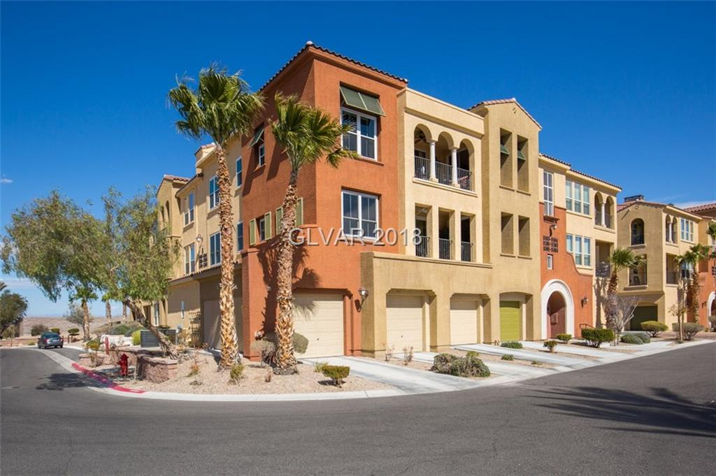 Beautiful former model home with Panoramic, million-dollar city/strip/mountain views. This condo in Terra Bella @ Sun City Anthem has it All! Large bedrooms/bathrooms, lots of storage, large deck with Gas Fireplace, Energy-efficient shutters on all windows, & upgraded kitchen with granite countertops and stainless appliances.  The community/building is gated and and has an elevator, courtyard, & huge detached 2-car garage. Great Location!
