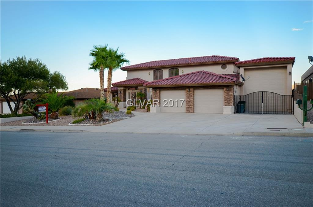 CUSTOM HOME W/ WONDERFUL LAKE & MOUNTAIN VIEWS**  LAKE MEAD NATIONAL RECREATIONAL AREA STARTS @ THE BACKYARD**  RV GARAGE BUILT IN 2015**  EVAPORATIVE COOLER INSTALLED 2013**  LOW MAINTENANCE POOL**  MASTER SUITE IS ON THE 2ND FLOOR W/A BALCONY** ACCESS TO POOL AREA FROM 2ND BEDROOM & FAMILY ROOM** CURRENTLY USED AS A  2ND HOME.  GREAT FOR  WEEKEND GET A WAY**