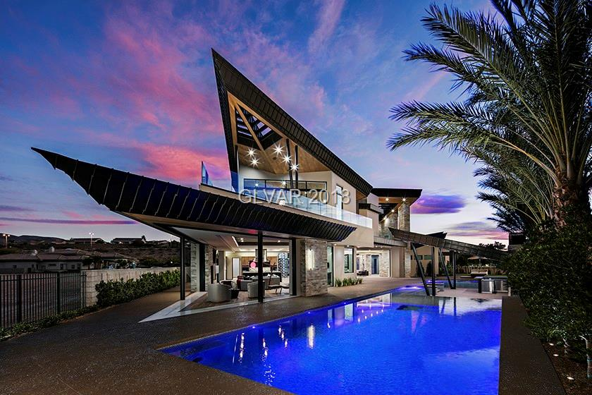 Sensational ultra-modern concrete and steel construction! One of a kind cutting edge compound with complete privacy and separate gated entrance. Home has stunning golf, mountain and strip views. 6 car garage, Casita, theater, elevator and custom kitchen. Designed by Custom Pinnacle Architecture.