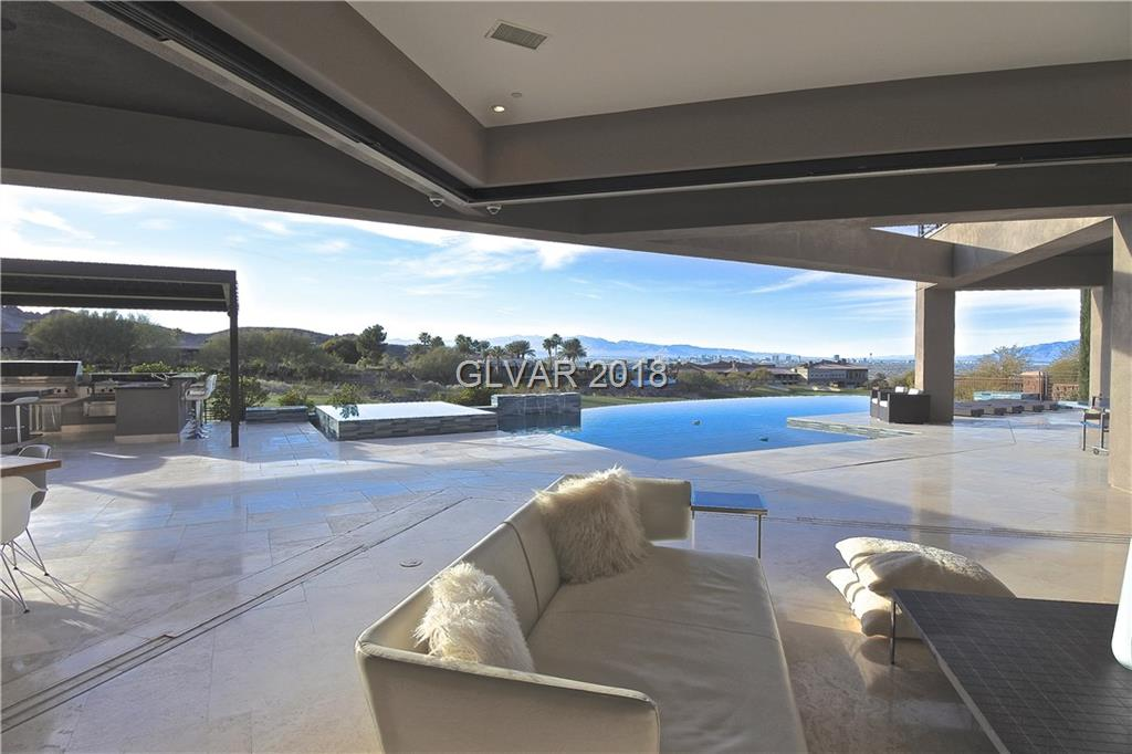 Exceptional Modern CUSTOM Home w/Commanding VIEWS of Strip/Fairway/Mountains! FLEXIBLE USE POSSIBLE OF 7 BRS ALL w/views/ensuite/custom closets! COUNTRY CLUB LIVING W/RESORT AMENITIES! 10ft x 36ft Wide Open Doors-Chef Designed Kitchen WOLF/SUBZERO-Fully Equipped Outdoor Kitchen! Separate Casita W/Priv Entry/GARAGE/kitchenette/PATIO. MASTER RETREAT-Spa Bath/Steam/Jacuzzi! THEATER-1200 bottle Wine Cellar-UNIQUE WATER/FIRE FEATURES! VW Deck/Misters!