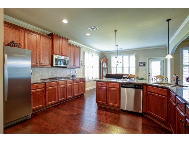Beautiful cabinets, stainless steel appliances & gorgeous granite accent this spacious kitchen!