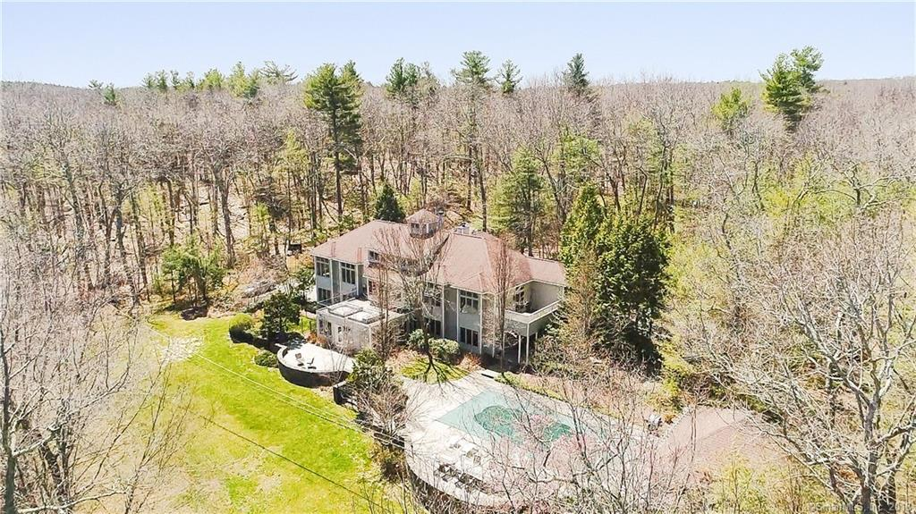 Tucked away in a quiet corner of Northern Rhode Island sits your very own waterfront oasis. This amazing estate truly offers it all. Set over 900' off the road sits a beautiful, sprawling colonial on Waterman Lake. The property offers over 10 acres of privacy, a putting green, tennis court, sprinklers, a stone patio and a 20x40 in-ground pool. The cabana offers its own kitchen and bath as well as plenty of space to entertain. Luxury living makes its way indoors with an open floor plan, hardwoods throughout, four plus beds, four baths, Thermador and Subzero appliances, a fantastic master suite and stunning water views. The lower level offers in-law potential with an additional kitchen and two full baths. Enjoy lazy days on the lake with your 40' private dock. This property is truly one of a kind.