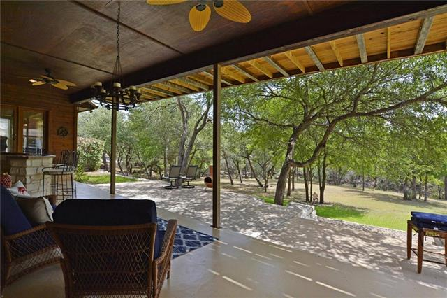Private ranch-style home nestled among lg beautiful oak trees just minutes from Lake Austin & 2 public boat ramps. Home lives like a 1 story w lg open rooms dwnstrs. Sweeping great rm upstairs designed 4 parties w bar & surround sound w 1 add' bd/bth. Huge covered porch to enjoy wildlife & entertaining guests.  Backs to pvt ranch. Gge apt w kitchenette & bath. Extended height/length 3 stall garage for boat/RV. STR permit (see agent). 3 lots w house & garage residing on 2. Completely unrestricted/no HOA.