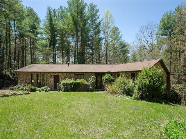Fantastic location near the heart of Flat Rock!  Great opportunity to make this spacious home yours.  2.7 acres, family room w/kitchenette for possible in-law space.  Just needs your decorative touch.