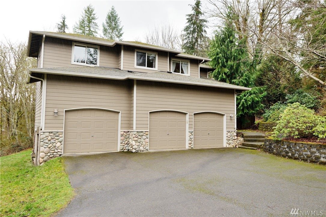 """Lovely Quail Creek home on a private .6 acre lot. Open 2-story foyer, 3 bedrooms, huge bonus room, den, 900+ sqft deck, hottub, raised garden spaces and greenhouse! Chair rail and shadowbox molding in the living/dining room areas for those """"formal"""" events! Kitchen remodeled w/3cm granite, FSC Certified cherry cabinets and Marmoleum flooring. Large space under the home for storage, shop area, etc.! Minutes to DT Redmond, 520, and other Eastside employers. Come visit us in Quail Creek!"""