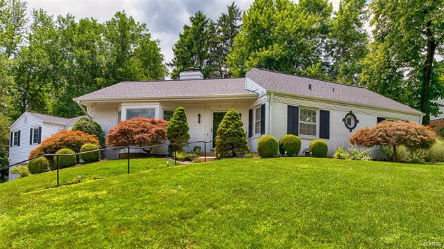 Charming and updated ranch home located in the Ladue School District in walking distance to Spoede Elementary. Living room with bay window & wood-burning fireplace. Newly remodeled kitchen featuring quartz counters, custom white cabinetry, center island & ceramic tile floors. Large morning hearth room with pavilion vaulted ceiling with doors that lead to the patio & garden. Family room with built-in bookcases & doors that open to the back patio. The private master suite is located on one wing of the home. It is bright with expansive windows & features a large walk-in closet. The master bath has dual vanities, granite counters, Jacuzzi tub & separate shower. 3 bedrooms & 2 full baths are located in the other wing of the home. The finished basement features a recreation room, home gym & half bath. 3 car garage. The backyard is fully fenced & secluded. Plenty of storage in the walk-up attic or this space can be transformed into more living area. Oak hardwood floors. New roof & driveway.