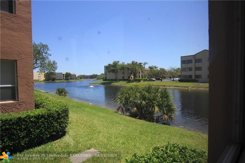 JUST REDUCED!! FIRST FLOOR BANYAN/FLORIDA ROOM WITH WATER VIEW. ALL TILES THROUGHOUT. NEW STOVE, NEWER A/C. 