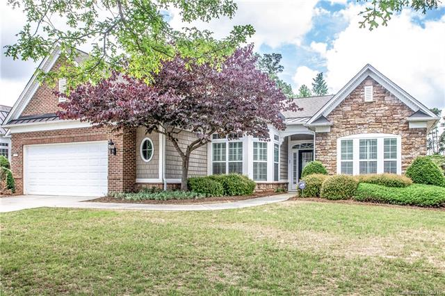 This Fabulous Cumberland Hall features 3BR/2.5BA with Study. Newly added 3-season room overlooking the private wooded yard is the highlight of this home.  Inside, gourmet kitchen includes granite counters, gas stove, stainless appliances, dining nook and pantry. Tray ceiling, crown molding, ceiling fans, wainscoting, and many more fine details are sprinkled throughout this lovely home. The paver patio overlooks the landscaped rear yard with irrigation system.  Come check out the active adult lifestyle and take advantage of the resort style amenities when you make  Sun City Carolina Lakes your new home! Age 55+