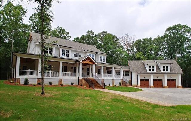 """Amazing one of a kind custom built estate on ten acres of picturesque wooded and rolling land in Wildwood Estates in Waxhaw!  You will not find another home like this out there!  This one of a kind gem is fully loaded featuring 10' ceilings on main and 9' up, huge living areas, coffered & barrel ceilings, wainscoting, laundry chute, wrap-around front & rear porches.  Kitchen features twelve foot island with two dishwashers, 36"""" farm sink, under-counter microwave drawer, Jenn-Air Professional appliances, floor to ceiling custom cabinetry topped with marble & granite, and exposed ceder beams.  Private 850sf master suite is appointed with spa bath covered in carrera marble, vessel soaking tub, heated floors, and enormous walk-in closet with second laundry hook up.  Honduran heart of pine floors are throughout main & common areas, built-ins galore, wired for whole house audio, guest suite & office over three-car garage with wet bar, and far too many details to list!  A truly MUST SEE!"""