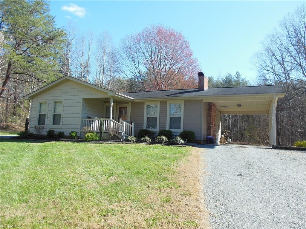 Want to live in town, but have a quiet country feel? This cozy 3 BR 2 BA house is move in ready! Large deck overlooking the back yard. Hardwood and tile floors. Nice stainless steel appliances Large walk out Master. Detached metal garage/ storage building. Close to schools and shopping. 30 minutes to Winston Salem. 20 minutes to Hanging rock State Park and Belews Lake.