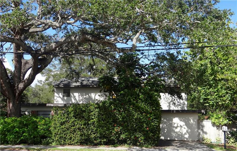 Custom designed two story family residence includes 4 bedrooms/ 2.5 baths with 2261 of square feet living area! Home is situated on a large corner lot with nice back yard and old Florida secluded landscaping. Enter the front door into a formal living/dining area with a nice den overlooking the private back yard/pool area. Three bedrooms and 2.5 bath downstairs make a very private space for guests or family members! Gorgeous Cypress stairwell leads you up the very large 14x20 private master suite with an actual loft area. Large balcony along the back side of the home great for relaxing! Home also includes a safe room or great for storage! Single car garage with rear and side patios. Enjoy walking down the street to Shoecraft Park! A little TLC will make this the perfect family home! Home centrally located, close to shopping and restaurants! Rooms sizes are approximate and should be verified.