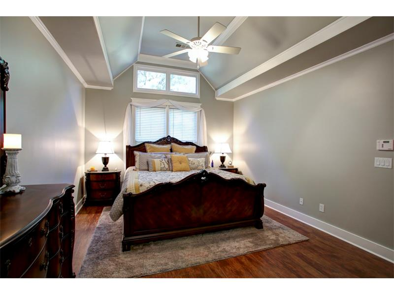 The hardwood flooring and trim details follow suit into the master suite. This master suite houses the control unit for the security system as well.