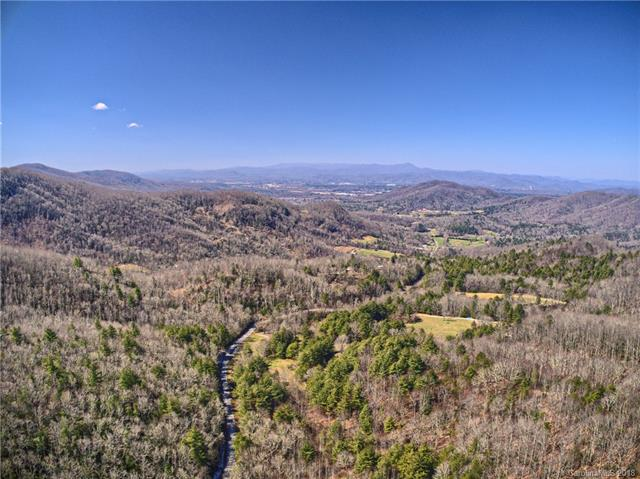 Multiple level ridge top building sites with 360 degree long range mountain views on this gorgeous 21+ acre parcel on Bearwallow Mountain. Huge westerly, sunset views towards Mt. Pisgah on one side, beautiful easterly sunrise views towards Fairview on the other. Just minutes to downtown Hendersonville, Asheville, Lake Lure and Chimney Rock. Seller is open to selling smaller parcels. Seller will grant road right of way access to the property from Bearwallow Rd.