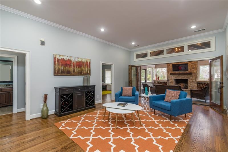 Stunning living room/sitting room is perfect for enjoying a quiet cup of coffee or entertaining guests...inside or outside!