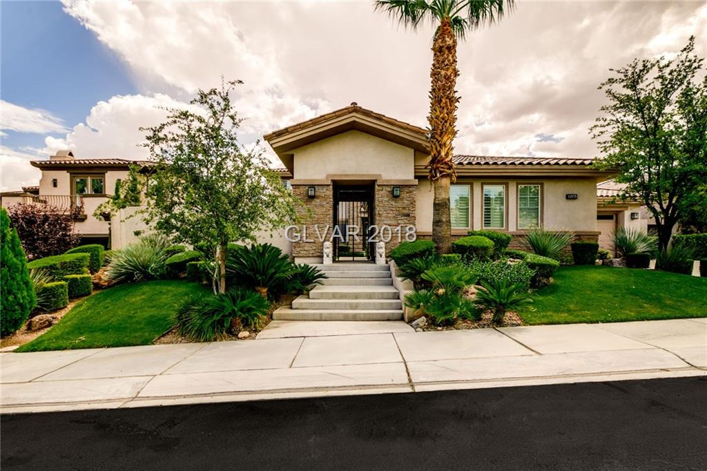 Welcome home to CC Living!Spectacular views *Full Strip*Championship Golf*Majestic Mountain.Secured crtyrd ent & spacious bckyrd patio offer addt'l outdoor entertaining.This beauty offers 4 bdrm en-suites,bonus office/den&entertainers bar.Master ste w/bonus sitting rm.An over sized home-site w/panoramic views can also be enjoyed on the mstr balcony.Marble finishes,custom built-ins are some of the interior design highlights.