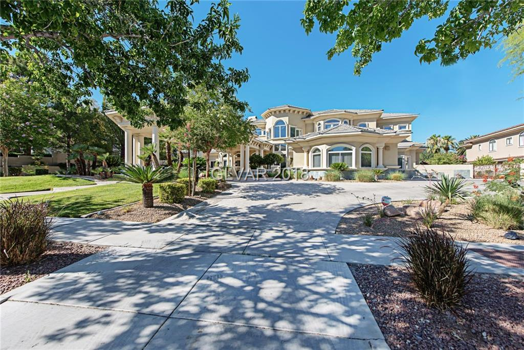 An Absolute Stunning 4 story home. Located on prestigious Tournament Hills  private Golf Course.Porte-Cochere entry. Oversized lot.Full size RACQUETBALL/BASKETBALL court.Movie theatre room, sits 11 .Elevator. Separate pool house w/ kitchen and full bath.Main house all rooms have in suite bathrooms.Gourmet Kitchen, walk in pantry.ENORMOUS office.Wet bars throughout.Additional 650 sq. ft. not in tax records.Three car garage. Must see to believe!