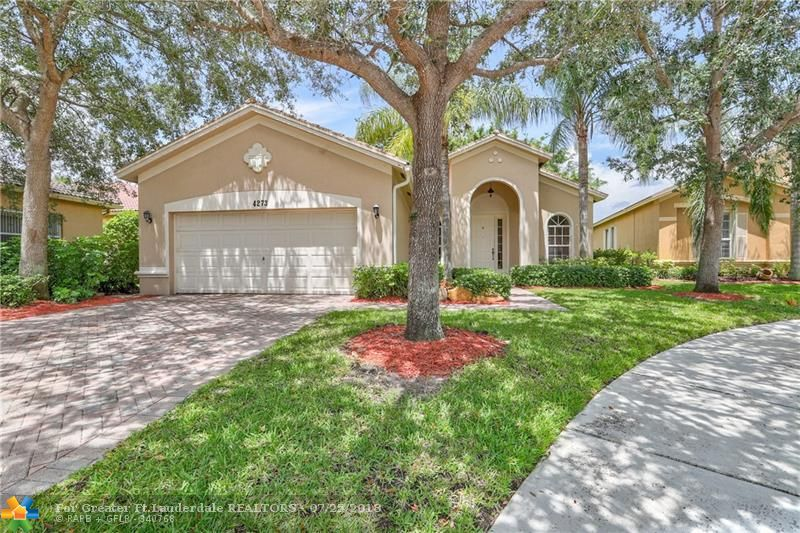 Beautiful 1 story lakefront home located in the Gated Isles at Weston.  True 4 bed 2 bath home, split floor plan, Open Kitchen, Breakfast area, vaulted ceilings.  Oversize lot, Extra long Driveway for 4 cars. Home Insurance only $1660! Low Hoa includes Basic Cable, Internet, Alarm. Just Appraised at $522,000,  Just inspected, Owner looking for quick sale.