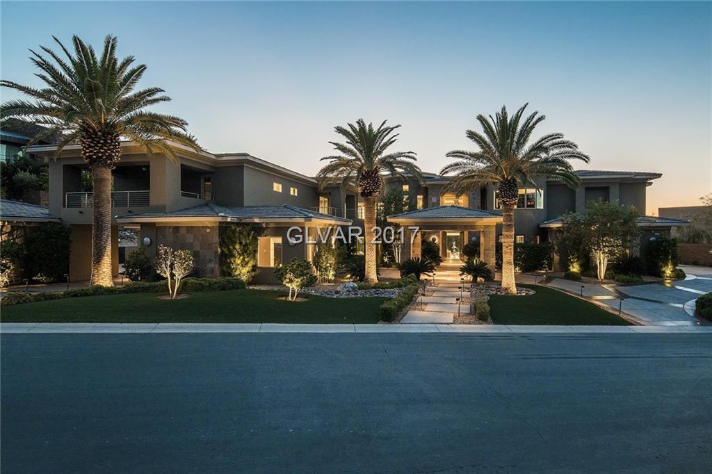 OFFERING FULL STRIP, GOLF & CITY VIEWS,THIS ESTATE W/ DETACHED CASITA OFFERS 7 BEDROOMS, 13 BATHROOMS; 8 CAR GARAGE (4 CLIMATE CONTROLLED); THEATRE THAT CAN SEAT 18-20; GYM OR DANCE ROOM W/RUBBER FLOOR; OFFICE; ULTRA LOUNGE, BILLIARDS ROOM WITH WET BAR;DUAL MASTERS UP&DOWN;GOURMET KITCHEN & PREP/CATERING KITCHEN ;DISAPPEARING DOORS TO OASIS BACKYD WITH OUTDOOR KITCHEN;LIMESTONE,HARDWOOD,MARBLE,STAINED CONCRETE FLRS;