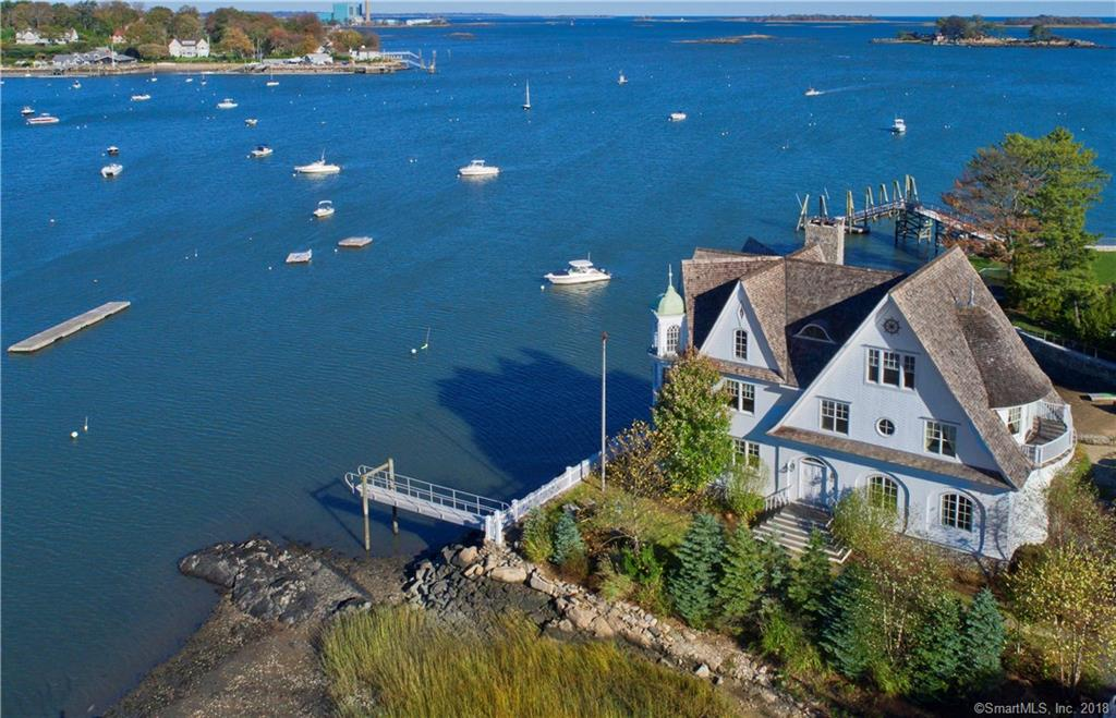 "Waterfront masterpiece, ""The Point"", as seen on NBC's Open House & featured in the Wall Street Journal is located on quaint, Bell Island, part of Rowayton, CT. This expansive 5 BR, 5 Bth home comes w/ a dock & a shared beach next to the house.  House has an open floor plan, w/waterviews from every window. From the moment you walk into this home w/ the front to back large foyer that draws you to the water,  you can feel & see how special, & well built this home is.  It has a spectacular gourmet kitchen, w/ large island, gas cooktop, steam oven, wall ovens, drawer refrigs, & Sub-zero refrigerator.  The breakfast area offers a built-in Miele coffee machine,w/an open dining rm & casual living rm w/ fpl. Great family space w/ mesmerizing views. 1st fl also has a home office, unique walk-in wine cellar, den or small BR w/ a beautiful nautical full bath. 2nd fl Master suite is everything you'd dreamed of..Huge MBR w/ unending water views, fpl, 2 walk-in closets, gorgeous master bath w/ double shower & separate deep air bath w/ vast water views. Very special! 2nd Flr has 2 other ensuite BR, laundry,& study area. The 3rd flr has 2 BR & Full bath. Also an exercise/rec space  w/ fpl & special architectural features, It's unique & grand w/cathedral ceilings. Home is sophisticated yet casual & has an unique infrastructure to keep it safe.  It's a must see if you're looking for a sensational architectural masterpiece. Walking distance to town.