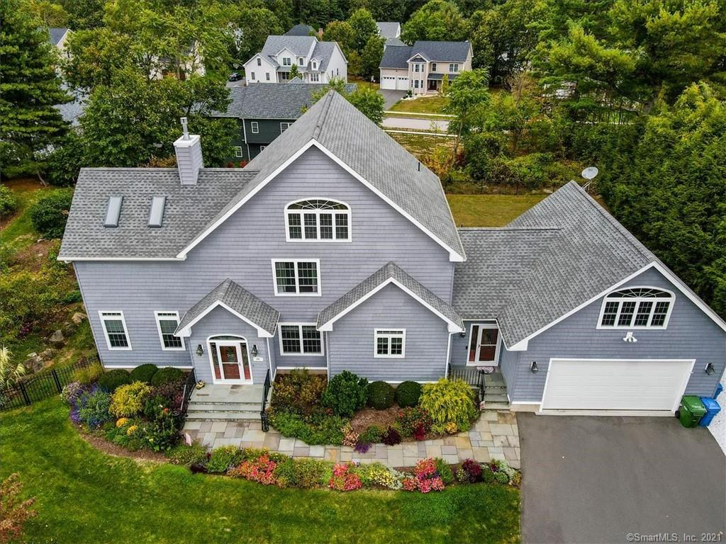 This impeccable custom built home exhibits pride of ownership one would expect. Quality of construction is apparent throughout with sleek moldings & finishes. Enjoy the majestic gardens, irrigation, & blue slate front/back patio & walkway installed/maintained by The Yard Group LLC & Landscape Specialties of CT LLC. Fenced in back yard. This well-appointed Colonial explodes with natural light & custom window treatments. Open Flr plan with acrylic infused bamboo flooring & an elegant spanning kitchen/dining area. Kitchen counters & breakfast island explode with expansive granite & slate back splash. High End energy efficient appliances & new Samsung refrigerator. The elegant dining room & living room display a natural gas Fireplace with floor to ceiling stone. First floor bedrooms expose new carpet & share a spacious full bathroom. The 2nd flr master bedroom suite features new carpeting, a natural gas FP, balcony area, master closet system, & additional closet. The master bathroom offers a heated floor, rain shower, jack & Jill vanity, and soaking tub w jets.  The MB suite has a double insulated wall.  The fabulous finished LL has a custom built in bar, pool table, fitness area, & gaming/entertaining area. Home features a 700 SF heated rm above garage & full bathroom. Come through garage to a mudroom & laundry room. Garage w/pull down storage suspended from ceiling, has hot/cold water, generator hook up, & epoxy flooring. Central vac. Weather sensor skylights, Ring 3 doorbell. This impeccable home exhibits the pride of ownership one would expect. Quality of construction is apparent throughout with its sleek moldings and finishes. Custom built by The Yard Group LLC- Eugene Darczyn. Enjoy the majestic mature gardens, irrigation, and blue slate front and back patio and walkway installed and maintained by The Yard Group LLC and Landscape Specialties of CT LLC.  Your feet will love the private lush back yard with fencing and gates. This timeless, well-appointed Colonial ex
