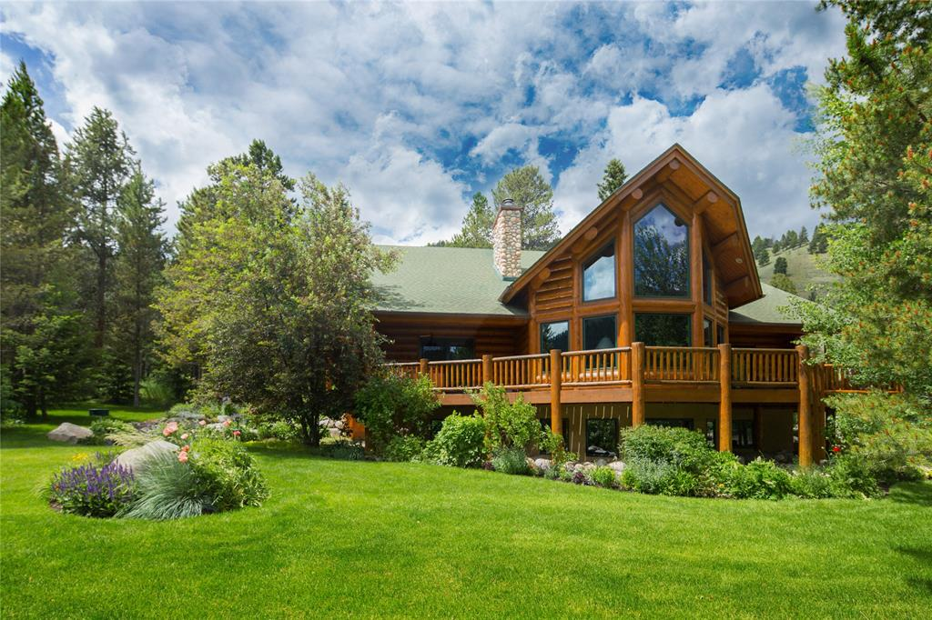 This spacious, open floor plan is the perfect spot to seek solace. Located on approx. 10 acres, there is plenty of space to enjoy, including a wraparound deck, and picturesque Gallatin River views. High ceilings and large windows are balanced by the warmth of the log construction and double sided stone fireplace. Separate guest suite attached on lower level.