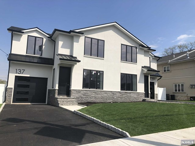 Extraordinary and sophisticated new construction duplex in a quiet residential area of Elmwood Park. Each side features a living room, dining room with sliding door to rear yard, gourmet kitchen with waterfall island, powder room and access to the garage from the first floor. Second floor offers a master bedroom with vaulted ceilings, walk-in closet and exceptionally elegant master bathroom. Additional 3 bedrooms and full bathroom as well as laundry on the second floor. Large finished basement with another full bathroom. High ceilings and hardwood floors throughout. Top of the line finishes and quality craftmanship. Must see to appreciate this one of a kind duplex/townhouse style rental. Required 1 month security, 1 month real estate fee and 1st month's rent.