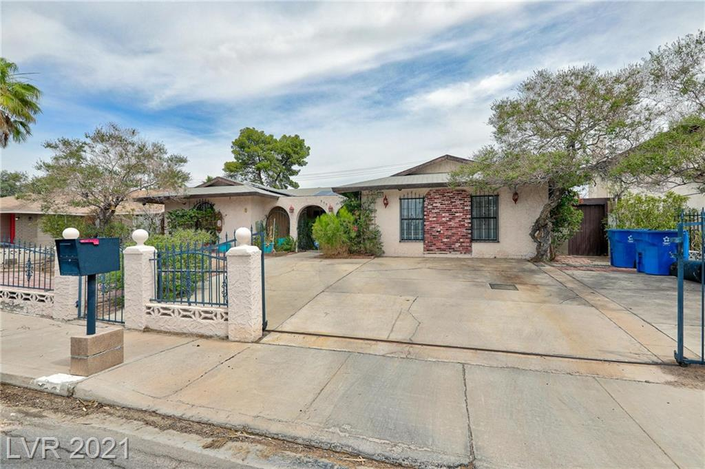 OPEN HOUSE this TUESDAY June 22 from 4pm-6pm. No HOA!!! Solar Panels are yours to Enjoy!! All paid for!! Must see this traditional sale!! Centrally located 1 story home with 4 bed/2 bath. Enclosed entry courtyard, 2 spacious living areas, 1 wood burning fireplace, open kitchen, open layout. Large master bedroom with add on, walk in closet. A lot of natural lighting throughout the home. Sun room is an add on, good for lounging and entertaining. Beautiful and large front and back yard, storage area on side of home. Strip view allows great 4th of July fireworks. Did I say No HOA??