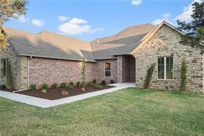 Truly gorgeous home on a half acre lot. Desirable addition with mature trees close to FAA, I-44/240 access, Will Rogers Airport, minutes from downtown OKC. Knock-out island kitchen with pantry is open to living room with cathedral ceiling and beautiful fireplace hearth. Spa-like master suite with oversized walk-in closet, double vanities, elegant slipper tub, custom tile shower and private water closet. Secondary beds share Jack n Jill bath, additional powder bath for guest use. Roomy utility area, on-trend mud bench and lots of storage. Great patio. This one is a stunner!