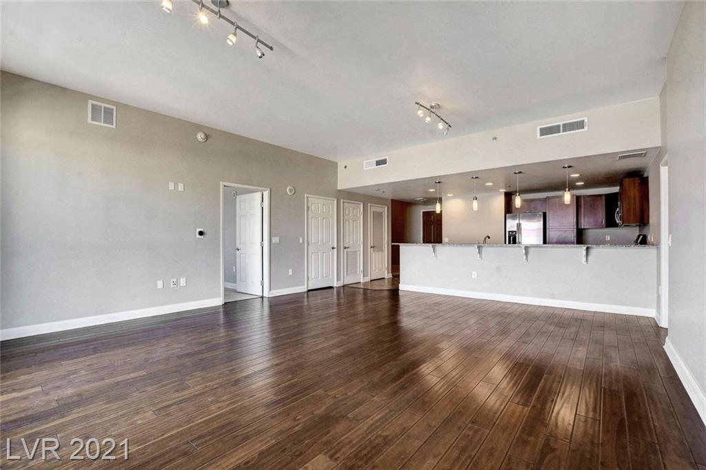 OWNER FINANCING!! RARE UNIT SITTING RIGHT ON LAS VEGAS BLVD AT AN INCREDIBLE PRICE!! AWESOME FLOOR PLAN Featuring TWO BEDS PLUS DEN.  OWN IN THE HOTTEST BUILDING IN THE HEART OF DOWNTOWN VEGAS. RIGHT OUT YOUR DOOR IS FREMONT STREET, THE WORLD FAMOUS ARTS DISTRICT, THE BEST DINING/BARS IN VEGAS. RARE FANNIE MAE APPROVED HIGH RISE. 24 HR SECURITY, ASSIGNED PARKING, CONCIERGE, FITNESS CTR, ROOFTOP POOL & SKYDECK. INCREDIBLE VALUE.