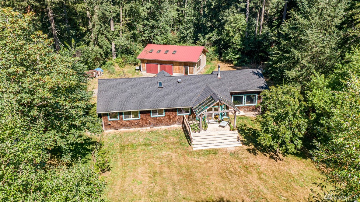 Let your island dream take shape on this gorgeous shy 5 acres w/lush fenced gardens, pasture w/feeding shed, 1200 sq. ft garage/shop, & private well. Spacious sunny areas offer respite, while the ideal, private location near schools, trails, equestrian park, farmstands, and beaches call to adventure! This lovely one story home is light filled w/open floor plan, vaulted ceilings, skylights, & convenient laundry/mudroom. Newer roof & fast Comcast complete the setting for this iconic Vashon farm!