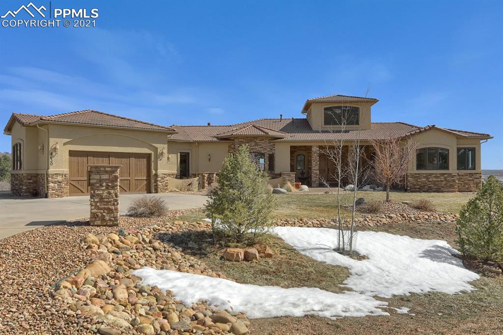 Beautiful Rancher on a Walk Out located on 2.5 acres! Incredible Location! 5 Bed, 7 Bath, 4 Car Garage! Large Wrap Around Deck with amazing views! Gourmet kitchen with upgrade appliances, island, granite countertops, & large pantry. Breakfast Nook/ Sitting area off kitchen with a fireplace! Large Laundry area with an additional 1/2 bath. Large Open Great Room with Fire Place and more Views! Separate Dining area! Main Level Master with large Master Bath and lots of closet space with additional washer/dryer hook up! Large lower level Family Room with Wet Bar and Fire Place and a Walk Out to a Patio & Hot Tub! 5 large bedrooms including Master on Main with an additional bedroom on the main level.(Could be used for an office or bedroom.) Custom Built-In Cabinets! Large area for Dog Run (wrought iron fencing off lower level.) 34 X 15 Court Yard Area! Large additional storage room in basement. Speakers for sonos music in the kitchen,family room,master bedroom,master bath,office,basement family room. Central Vac. Come enjoy the Monument lifestyle located in the foothills of Colorado Springs/Monument  with access  to miles and miles of hiking trails right out your back door! (See Interactive Floor Plan on Virtural Tour for room sizes and details of floor plan!)